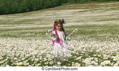 Girl among flowers. Slow motion
