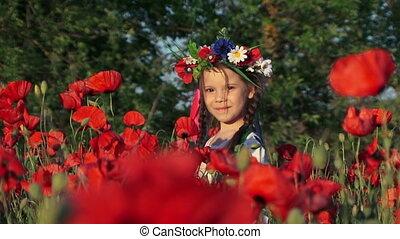 Girl among poppies