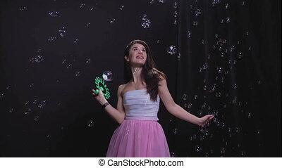 Girl among soap bubbles