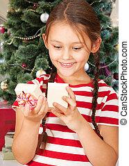 Girl and a Christmas gift
