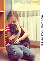 girl and a German Shepherd puppy