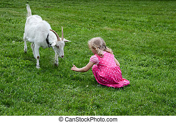 girl and a goat