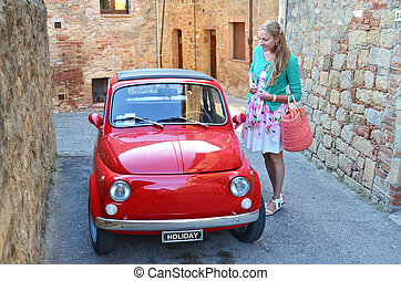 Girl and a red vintage car on the narrow Italian street