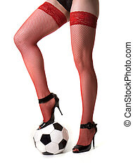Girl and ball - Girl in red stockings keeps foot on ball