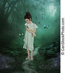Girl and birdie - The little girl holds birdie, bullfinch on...