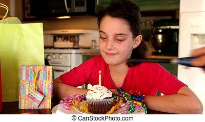 Girl and Birthday Cupcake