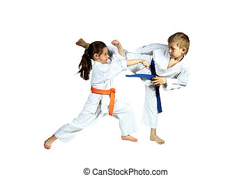 Girl and boy are training exercises - Girl and boy in...