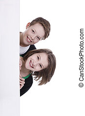 Girl and boy behind an empty wall