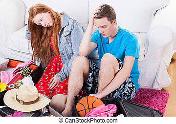 Girl and boy having problems with packing