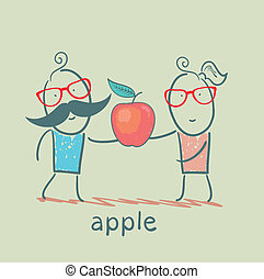 girl and boy holding an apple