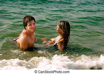girl and boy in a sea