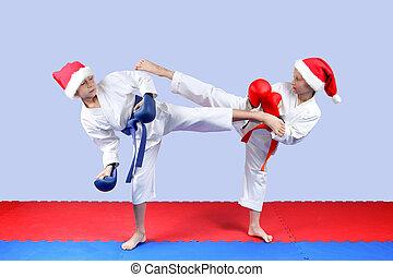 Girl and boy in cap of Santa Claus