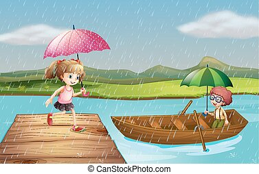 Girl and boy in the rain at the park