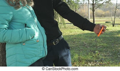 Girl and boy making selfie using a mobile phone - School...
