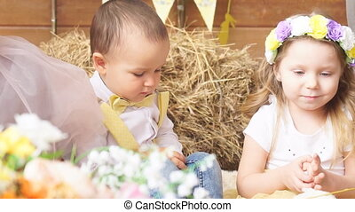 Girl and boy models are photographed with a chicken