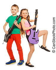 Girl and boy rock playing on electro guitars and dancing on...