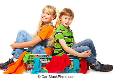 Girl and boy sitting in clothing basket