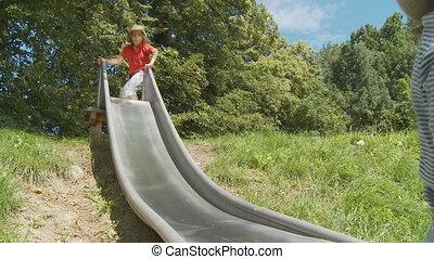 girl and boy sliding