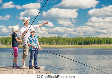 girl and boy with dad learn to fish, weekend fishing