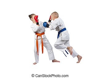 Girl and boy with overlays on his hands is beating blow in jump