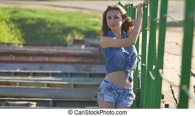 Girl and bridge. Beautiful sexy girl is standing on a bridge...