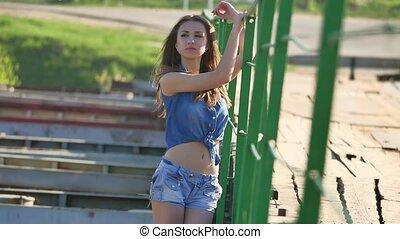 Girl and bridge lifestyle. Beautiful sexy girl is standing...