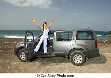 Girl and Car - Woman and her 4wd car at Fuerteventura\'s...