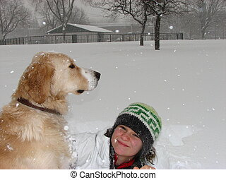 Girl and dog in snow - A girl sitting in the snow with her...