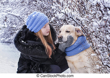 girl and dog in the winter park