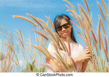 Girl and Feather pennisetum