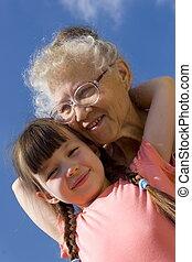 Girl and grandma on sky