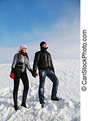 girl and her boy friend have a rest highly in mountains and...