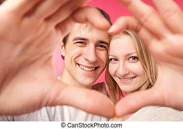 Girl and her boyfriend making heart