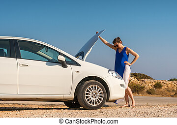 girl and her broken white car