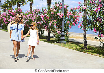 Girl and her mother at the seaside