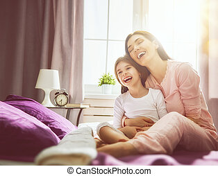 girl and her mother enjoy sunny morning