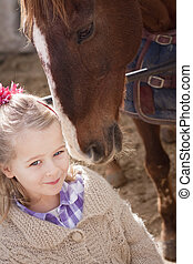 Girl and horse - Young child with brown pony