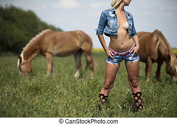 Girl and horse - The naked girl on the background of the...