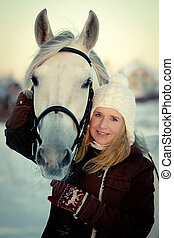 Girl and horse - Beautiful young woman and Tersk stallion