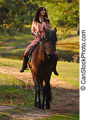 Girl and horse - Young beautiful woman and a horse on nature...