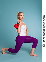 Girl and kettlebell - Fitness girl on squat position with a...