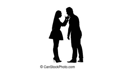 Girl and man are arguing, they have a scandal. Silhouette....