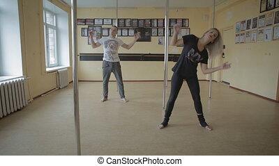 Girl and men dancing strip plastic in dance studio stock footage video