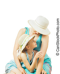 Girl and mother looking at each other isolated on white background.