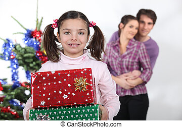Girl and parents with Christmas presents