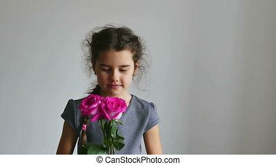 girl and rose flowers - girl teen smelling a rose flowers on...