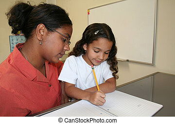 Girl and Teacher - Young girl and teacher at computer