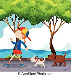 Girl and two dogs walking on street