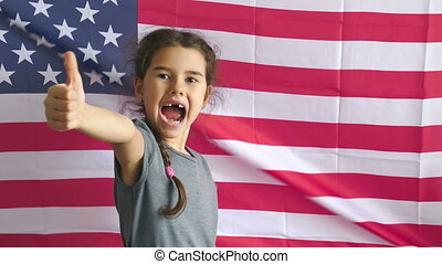 Girl and USA American Flag - boy teen shows gesture yes...