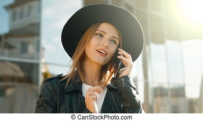 Girl Answers Phone Before Modern Building - Slim caucasian...